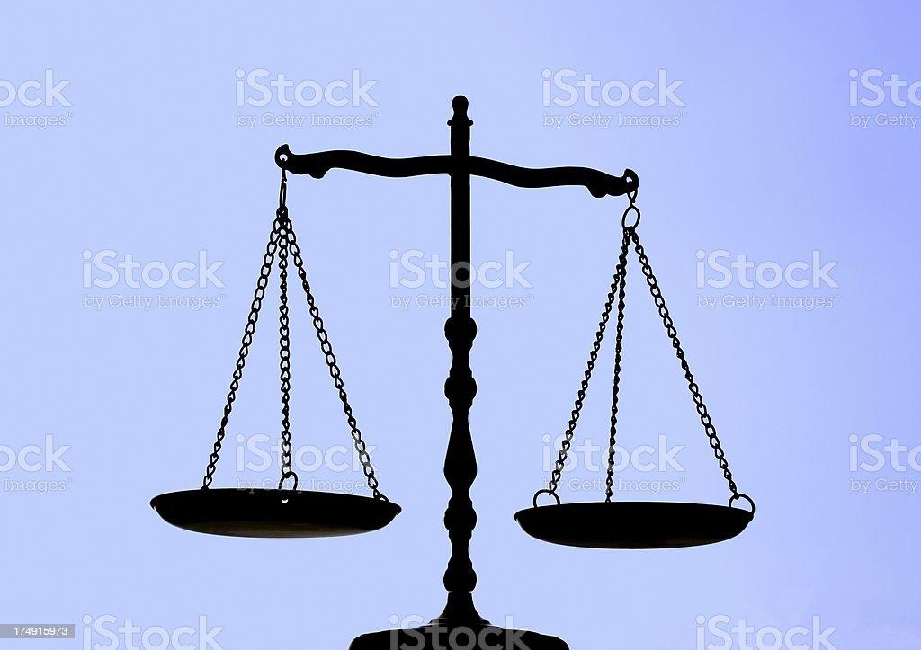 Balance Scale On Blue Background royalty-free stock photo