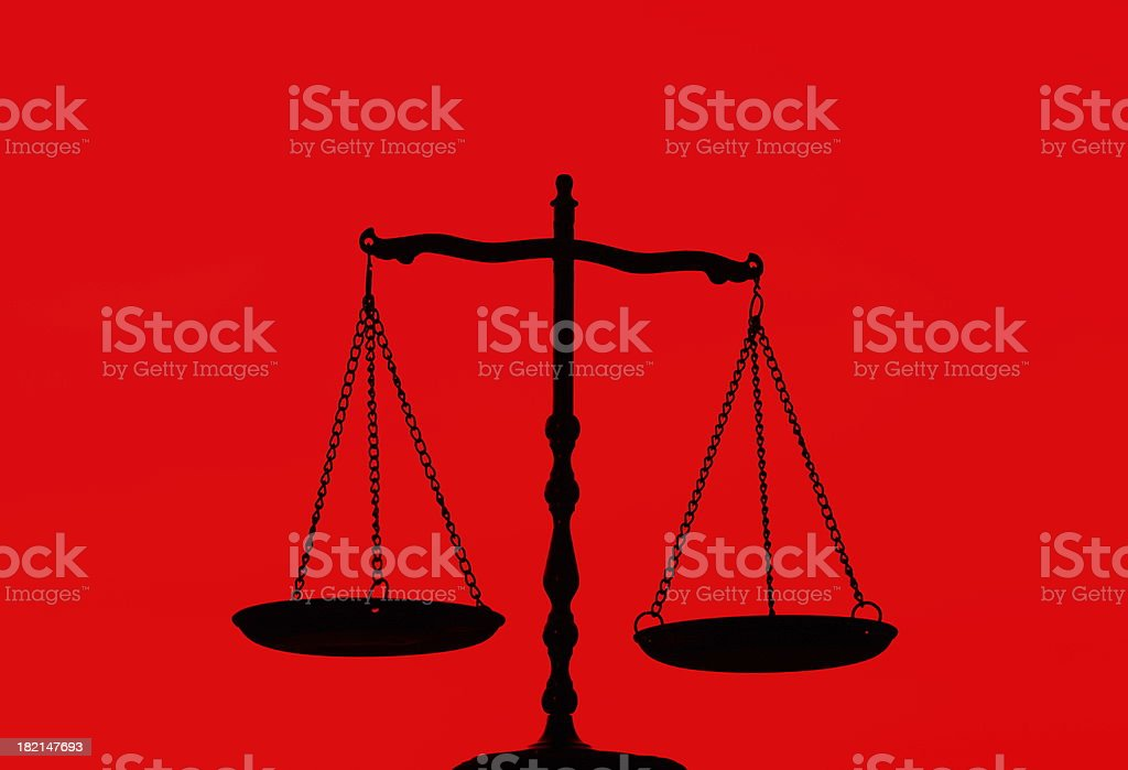 Balance Scale On Red Background royalty-free stock photo