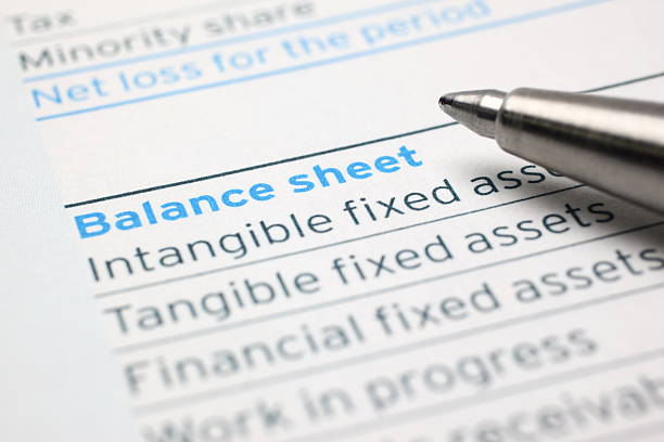 Balance Sheet Close-up of a pen on balance sheet.Similar images - bank statement stock pictures, royalty-free photos & images