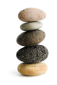 Subject: The zen of five pebbles stacked in a column. Isolated on a white background.