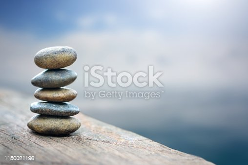 Balance stone with spa on river coast