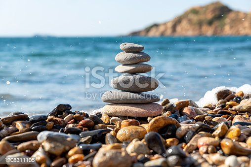 Balance stones. Pebbles on the beach by the sea.