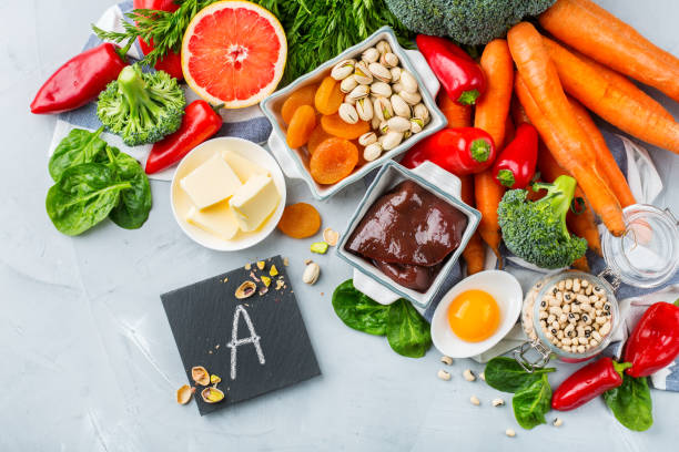 Balanced clean eating nutrition, food rich in vitamin a Balanced diet nutrition, healthy clean eating concept. Assortment of food sources rich in vitamin a on a kitchen table. Copy space background biological process stock pictures, royalty-free photos & images