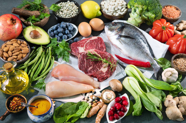 Balanced diet food background Balanced diet food background. Selection of various paleo diet products for healthy nutrition. Superfoods, meat, fish, legumes, nuts, seeds, greens and vegetables healthy eating stock pictures, royalty-free photos & images
