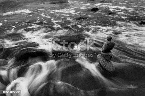 Stones balance against flowing tides.