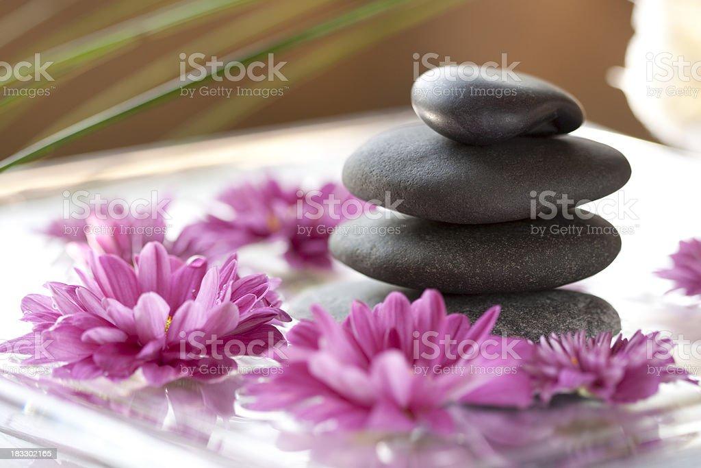 Balanced massage stones spa scene royalty-free stock photo