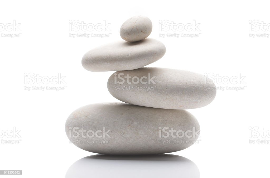 Balanced pebbles, isolated on white background with reflection stock photo