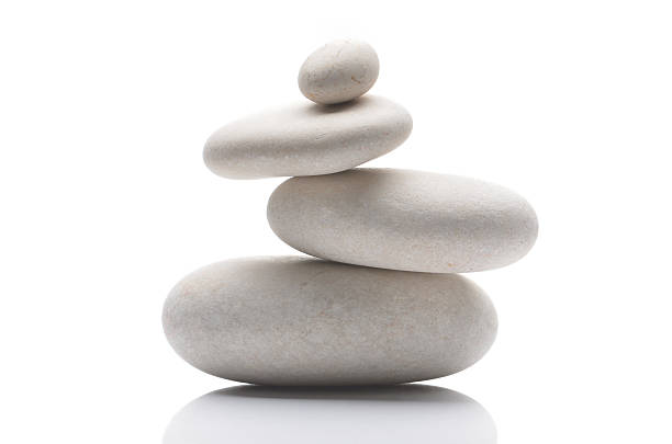 Balanced pebbles, isolated on white background with reflection - Photo