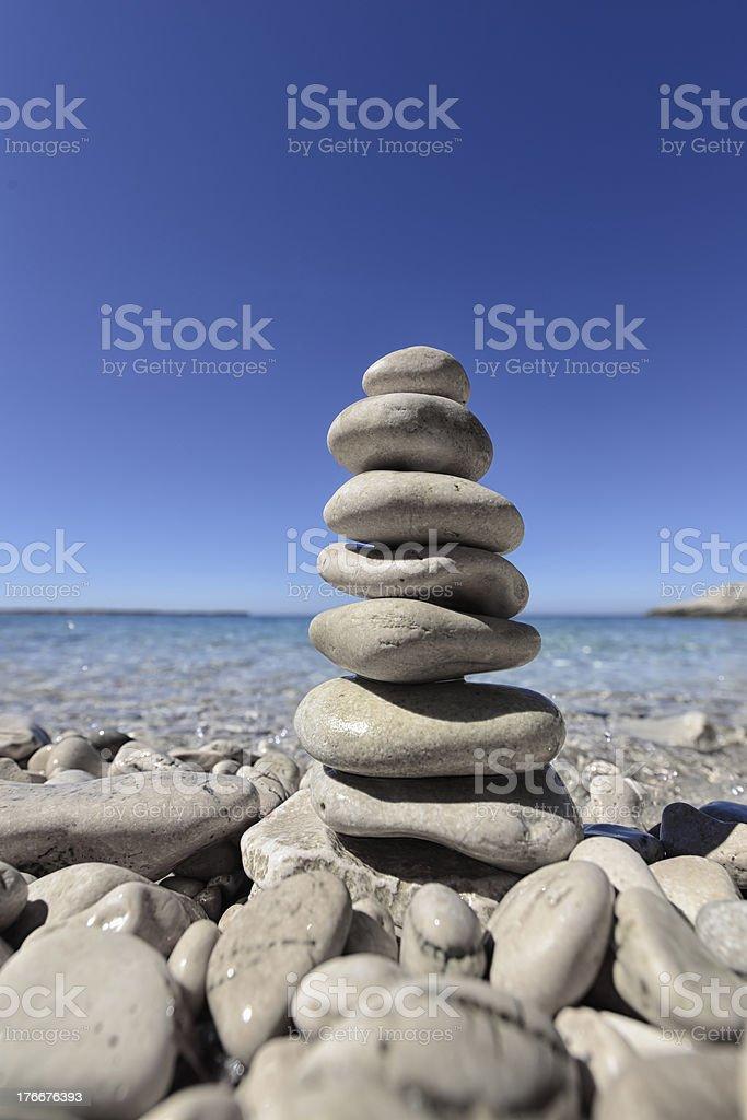 Balanced Pebbles on a Beach royalty-free stock photo