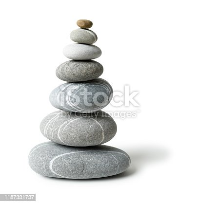 Balanced pyramid of pebbles isolated on white with clipping path and natural shade.