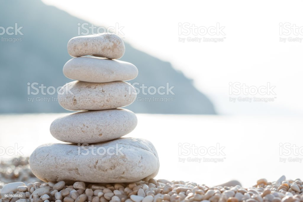 Balanced stones on a pebble beach during sunset. Myrtos beach, Kefalonia, Greece, Europe stock photo