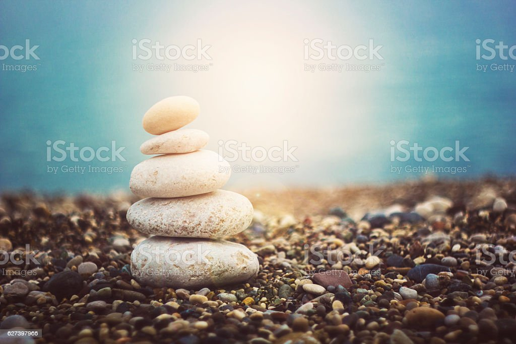 Balanced stones on a pebble beach stock photo