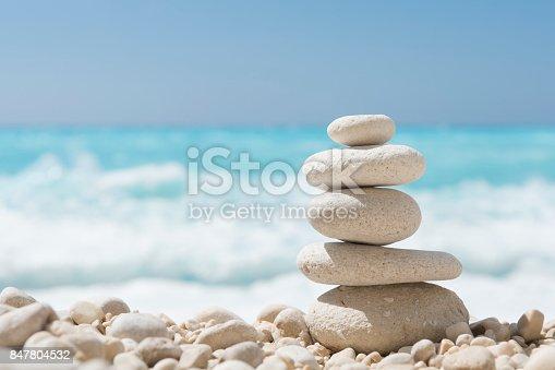 istock Balanced stones on a pebble beach 847804532