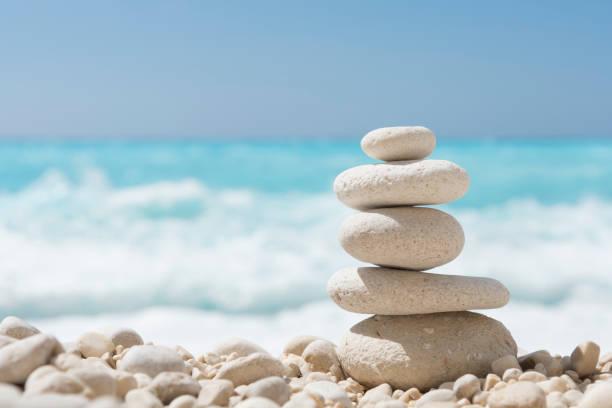Balanced stones on a pebble beach stock photo