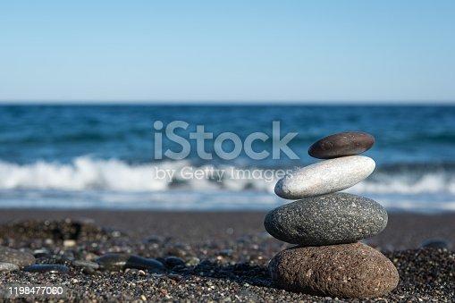 591835714 istock photo Balanced stones on the beach 1198477060
