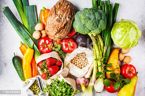 istock Balanced vegetarian food background. Vegetables, fruits, berries, nuts, sprouts, seeds, chickpeas on a white background, top view. 1152434055
