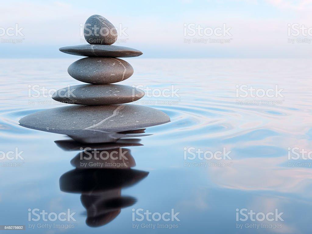 Balanced Zen stones in water stock photo