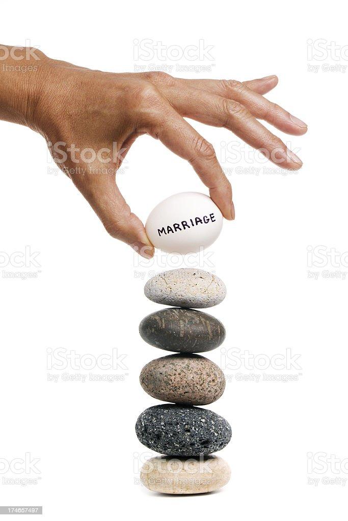Balancing Act - Marriage royalty-free stock photo