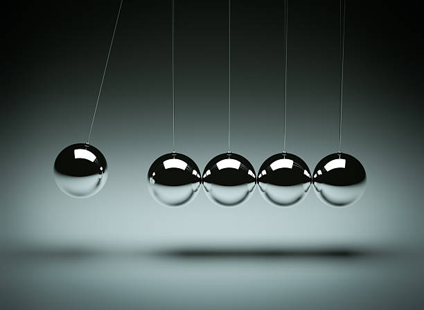balancing balls newton's cradle - stability stock photos and pictures