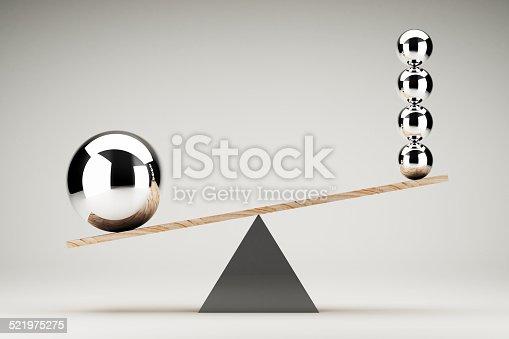 istock Balancing balls on wooden board conception 521975275