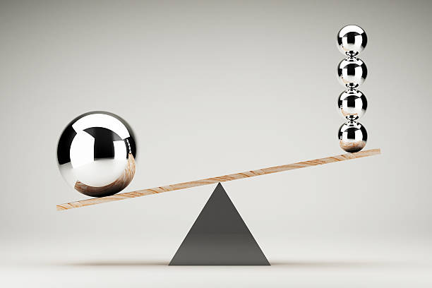 Balancing balls on wooden board conception stock photo