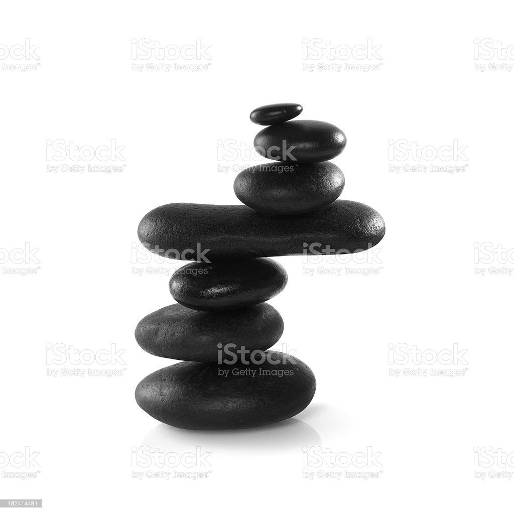 Balancing black stones royalty-free stock photo