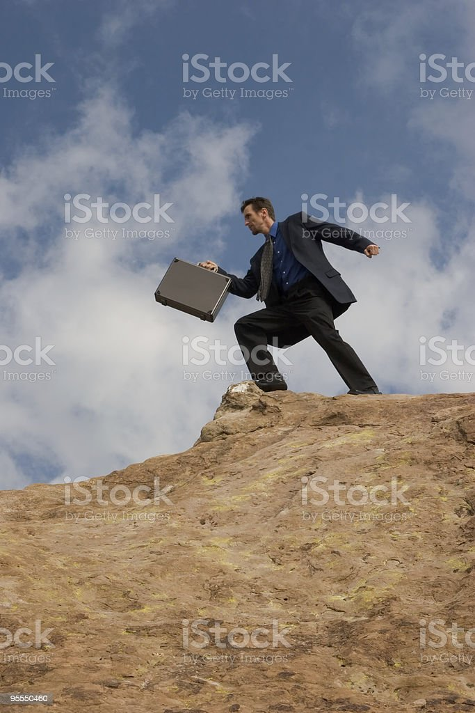 Balancing business on the precipice of success royalty-free stock photo