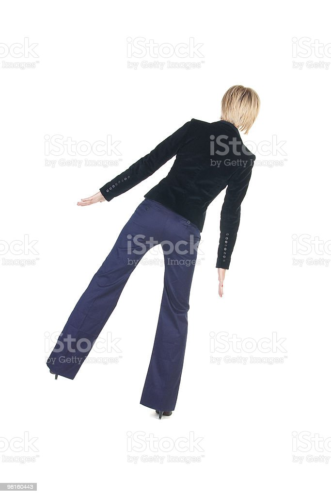 balancing businesswoman . Rear view royalty-free stock photo
