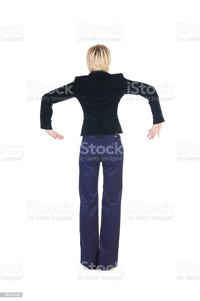 balancing businesswoman . Rear view royalty-free stock photo