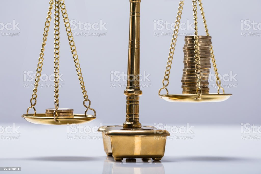 Balancing Coins On Scale stock photo