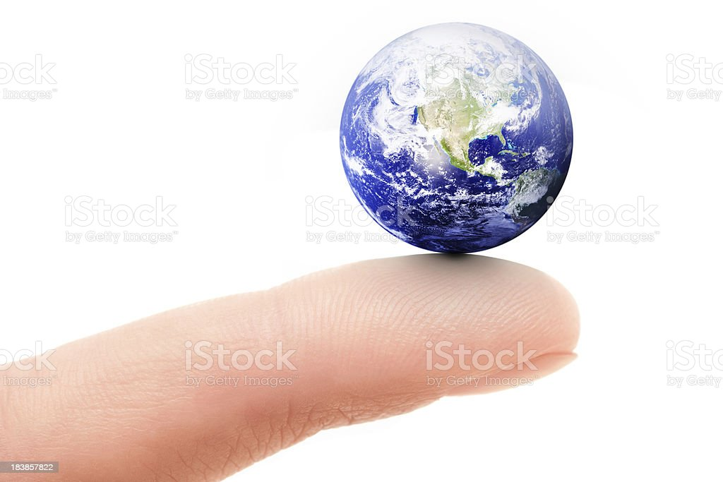 Balancing Earth on Fingertip stock photo