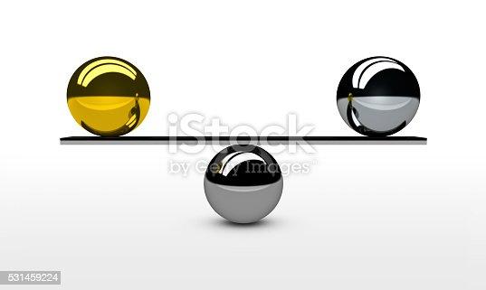 istock Balancing Gold Silver Balls Concept 531459224