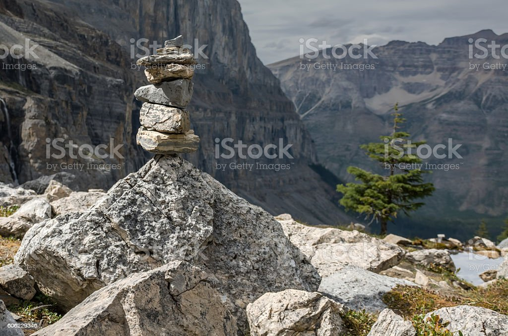 Balancing Inukshuk on a Mountain Top stock photo