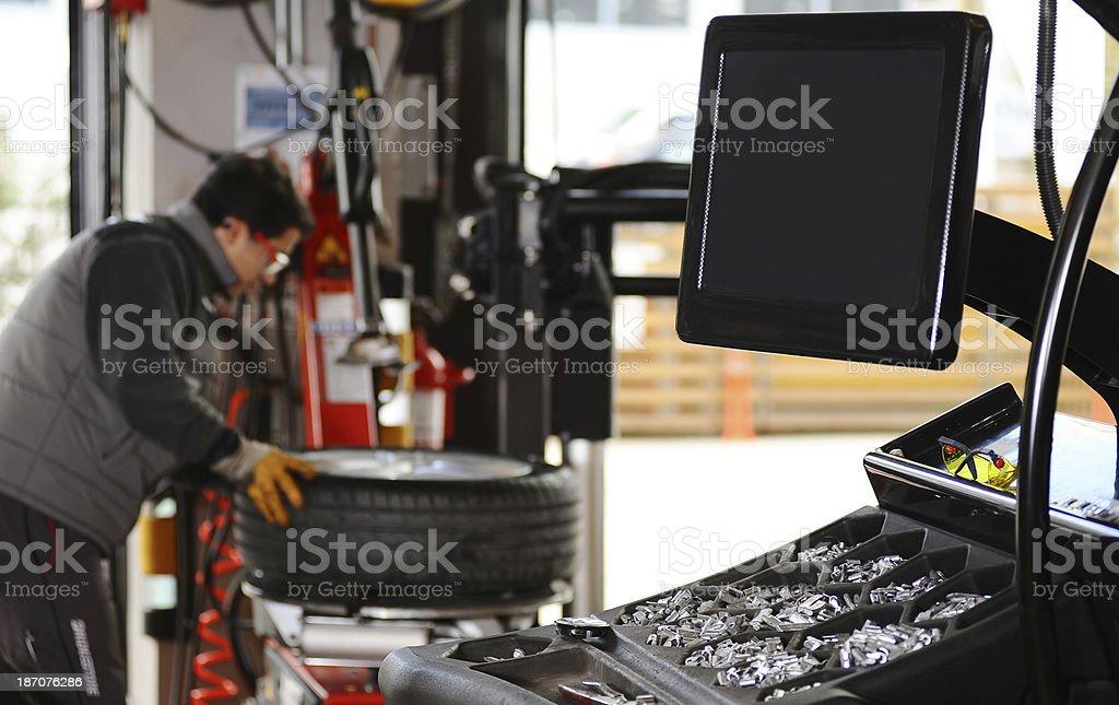 Balancing machine and mechanic royalty-free stock photo