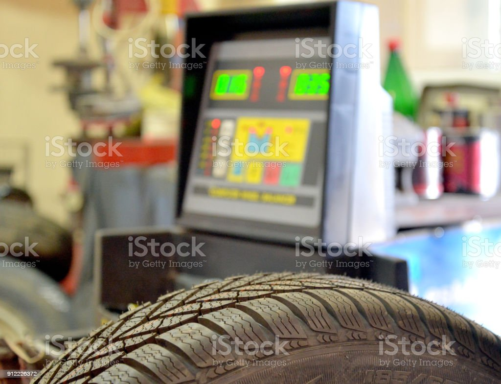 balancing new tire in a workshop stock photo