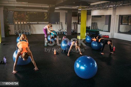1195045259istockphoto Balancing On Fitness Ball 1195045734