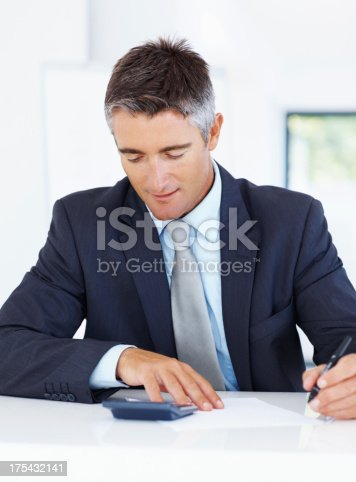 istock Balancing out his finances - Budgeting 175432141