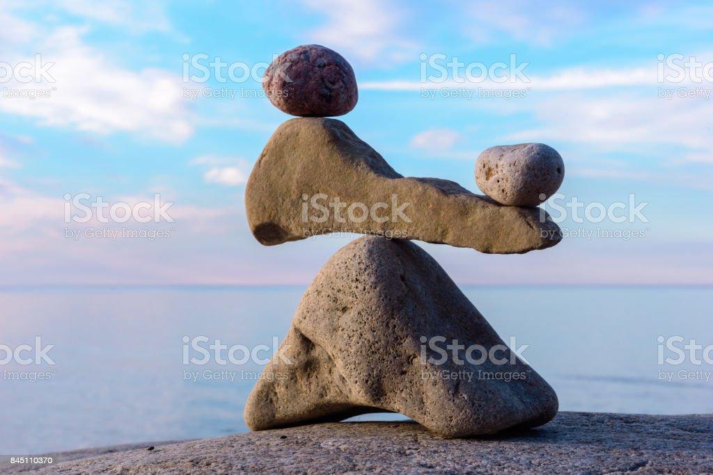 Balancing several stones stock photo