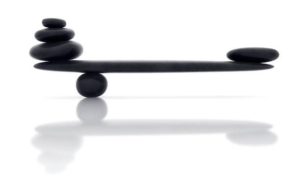 Balancing smooth black stone with reflection stock photo