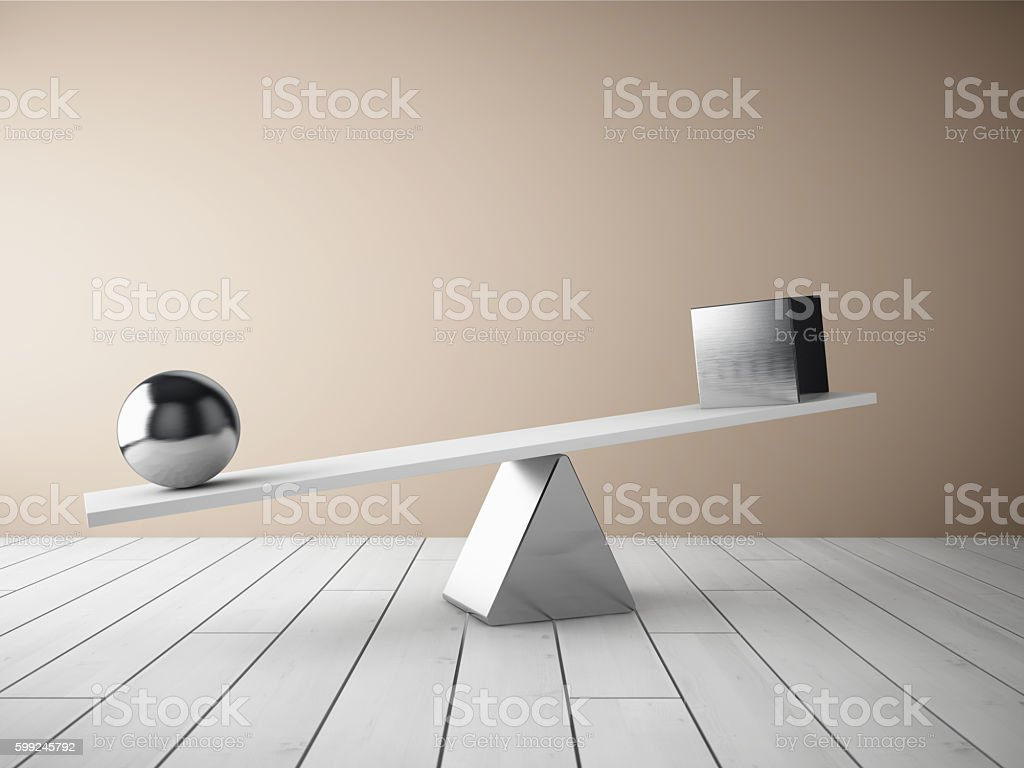 Balancing steel ball and cube stock photo