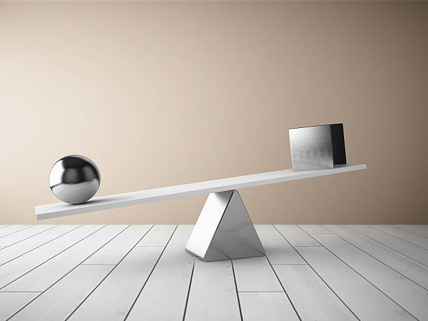 balancing steel ball and cube - imbalance stock photos and pictures
