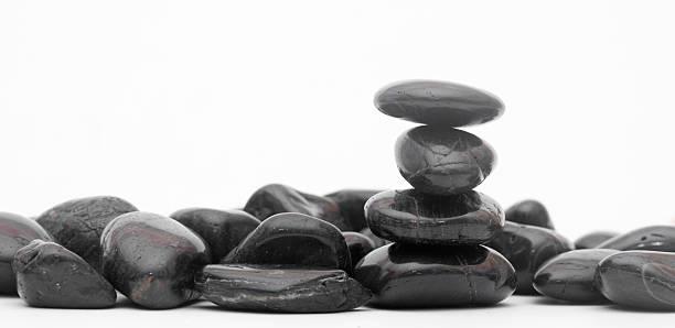 balancing stones isolated on a white stock photo