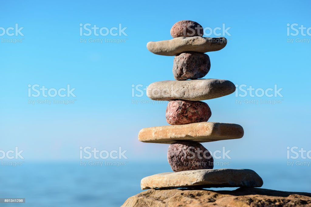 Balancing stones on the seashore stock photo