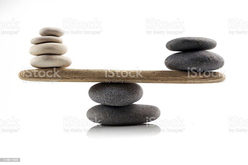 balancing stones on white stock photo