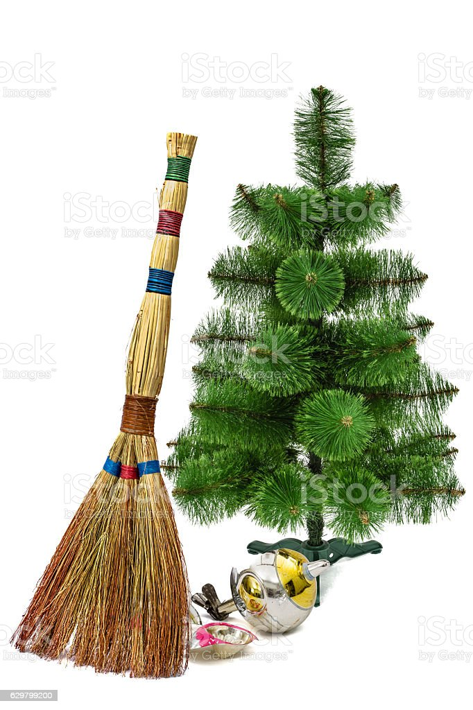 balayage of broken christmas decorations with the help of besom royalty free stock photo - Christmas Broom Decoration
