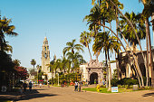 San Diego, California, USA: September 18, 2016: People walk along the pathways in Balboa Park. It contains museums, several theaters, and the world-famous San Diego Zoo.