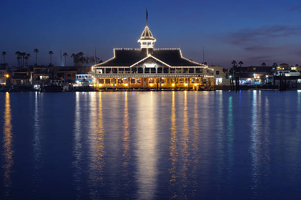 """Balboa Pavilion """"Newport Beach, USA - December 30th, 2011: Balboa Pavilion, established on July 1, 1906, is a marine recreational facility with transportation terminal, boat rentals, banquets, receptions, and conferences, and located on the Balboa Peninsula in southern California."""" pavilion stock pictures, royalty-free photos & images"""