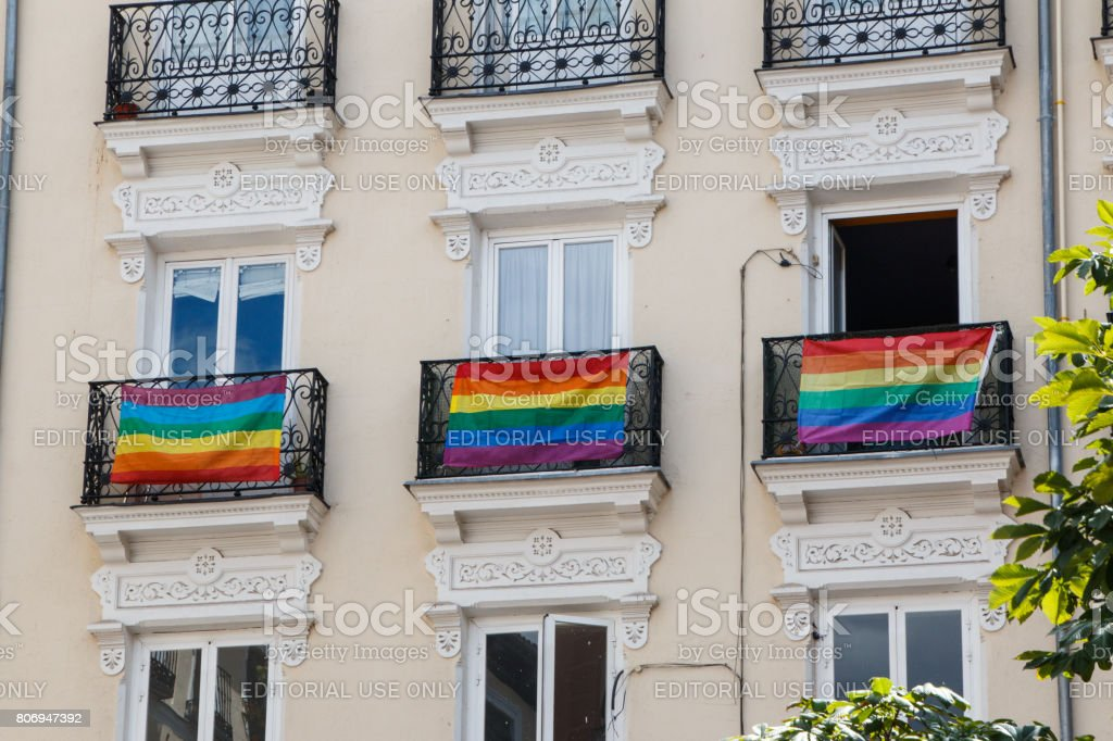 Balconies adorned with the rainbow flag of the World Pride stock photo