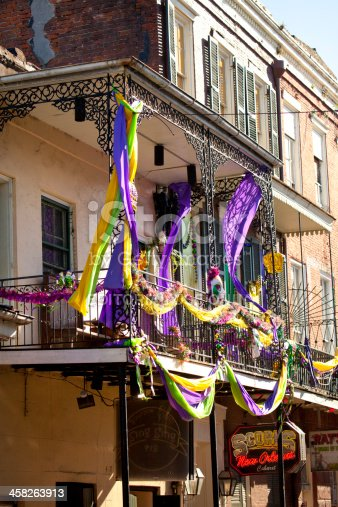 New Orleans - USA - March 4, 2012:Balconies are decorated with Mardi Gras colors of purple, green and gold in the French Quarter, New Orleans, Louisiana.  The Mardi Gras colors of purple, green, and gold represent justice, faith and power respectively.represent