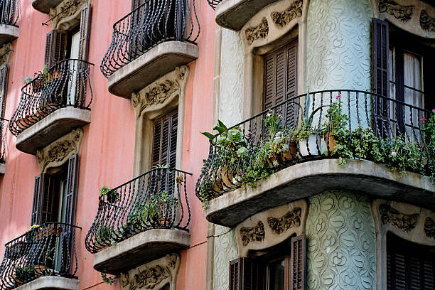 Balconies in Barcelona Balconies in Barcelona. A shot taken in the Gracia area. Can be used as a background. gracia baur stock pictures, royalty-free photos & images